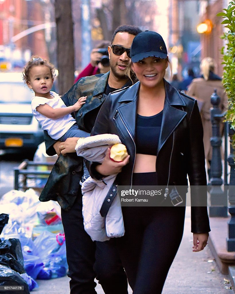John Legend, Chrissy Teigen and their daughter Luna seen out walking in Manhattan on February 20, 2018 in New York City.
