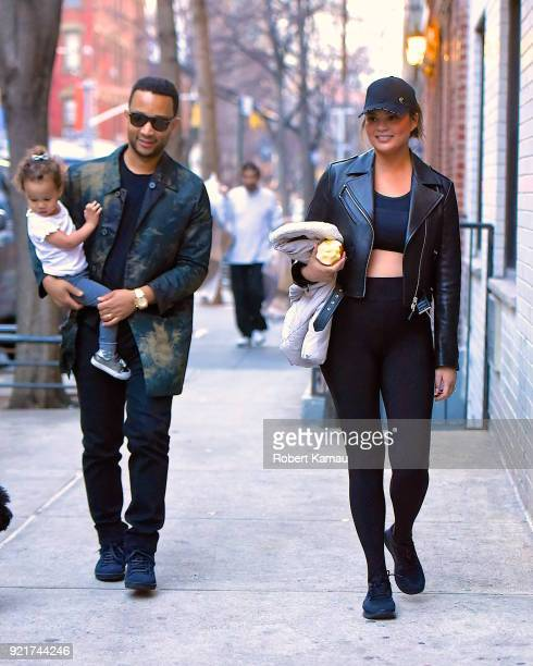 John Legend Chrissy Teigen and their daughter Luna seen out walking in Manhattan on February 20 2018 in New York City