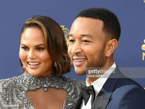 John Legend Chrissy Teigen arrives at the 70th Emmy Awards on September 17 2018 in Los Angeles California