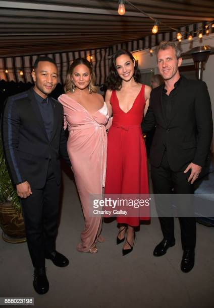 John Legend Chrissy Teigen Gal Gadot and Yaron Versano attend GQ and Dior Homme private dinner in celebration of The 2017 GQ Men Of The Year Party at...