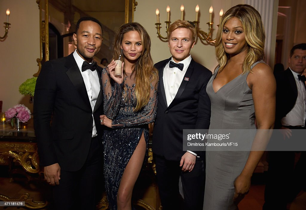 John Legend, Chrissy Teigen, Ronan Farrow, and Laverne Cox attend the Bloomberg & Vanity Fair cocktail reception following the 2015 WHCA Dinner at the residence of the French Ambassador on April 25, 2015 in Washington, DC.