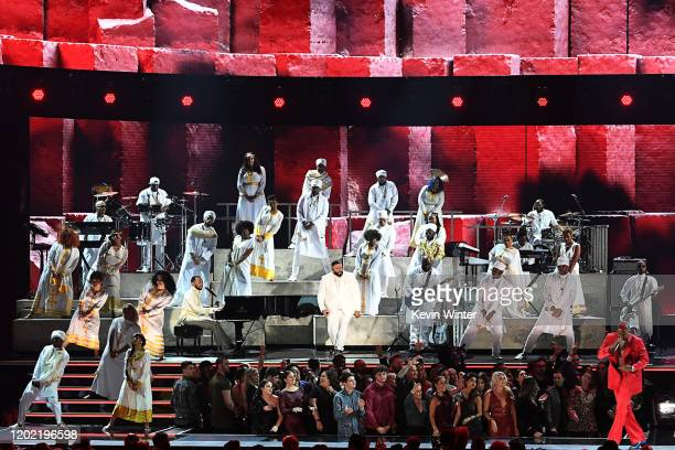 John Legend DJ Khaled and YG perform onstage during the 62nd Annual GRAMMY Awards at STAPLES Center on January 26 2020 in Los Angeles California