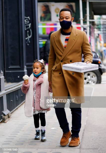 John Legend holds the hand of his daughter Luna out for ice cream on March 06, 2021 in New York City.