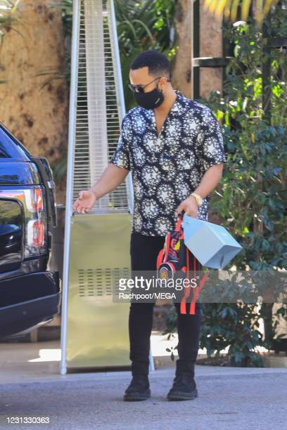 John Legend is seen at Wolfgang Puck in Bel Air on February 22, 2021 in Los Angeles, California.