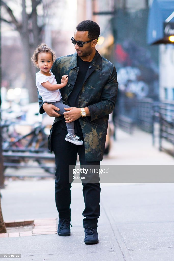 John Legend is seen carrying his daughter Luna in SoHo on February 20, 2018 in New York City.
