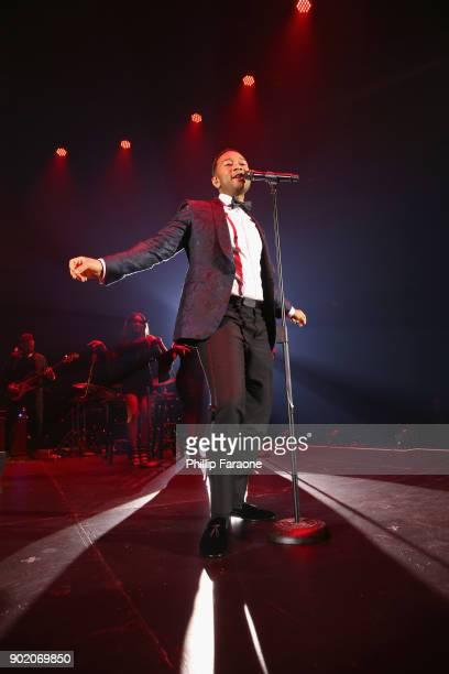 John Legend performs onstage at The Art of Elysium presents John Legend's HEAVEN at Barker Hangar on January 6 2018 in Santa Monica California