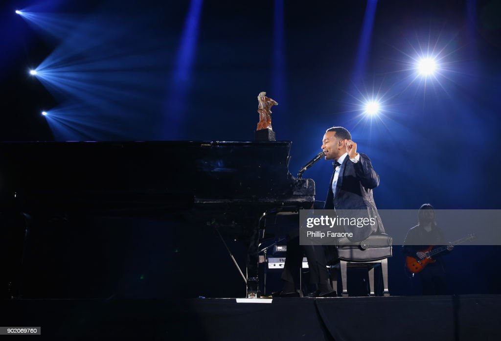 John Legend performs onstage at The Art Of Elysium's 11th Annual Celebration with John Legend at Barker Hangar on January 6, 2018 in Santa Monica, California.
