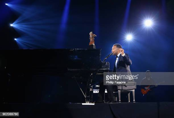 John Legend performs onstage at The Art Of Elysium's 11th Annual Celebration with John Legend at Barker Hangar on January 6 2018 in Santa Monica...