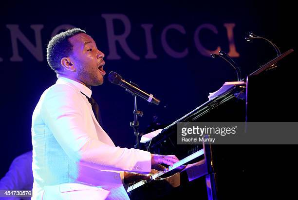 John Legend performs onstage during the white party dinner hosted by Andrea and Veronica Bocelli celebrating Fight Night In Italy benefitting The...