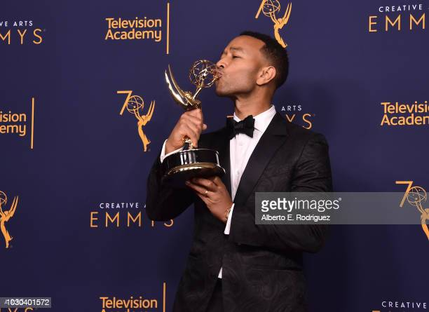 John Legend poses in the press room during the 2018 Creative Arts Emmys at Microsoft Theater on September 9 2018 in Los Angeles California