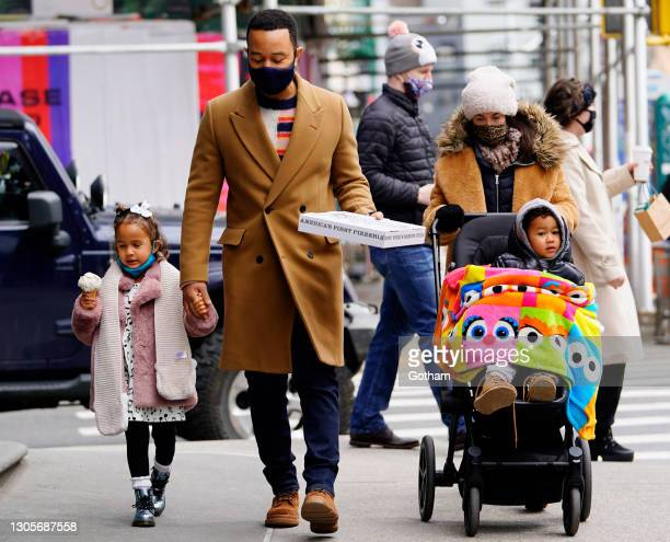 John Legend takes daughter Luna and son Miles for ice cream and pizza on March 06, 2021 in New York City.