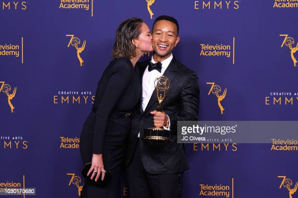 John Legend, winner of the award for outstanding variety special for 'Jesus Christ Superstar Live in Concert', and wife Chrissy Teigen pose in the...