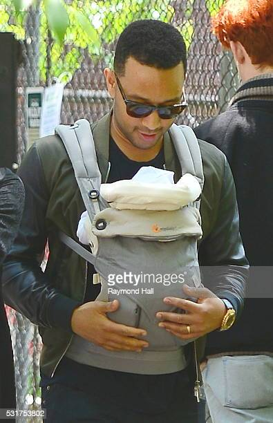John Legend with baby Luna Legend is seen walking in Soho on May 16 2016 in New York City