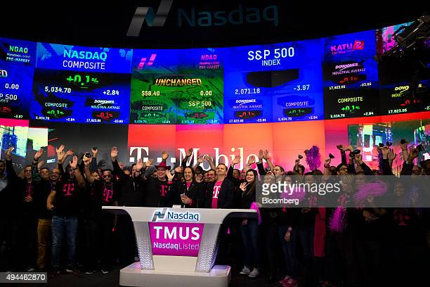 John Legere chief executive officer of TMobile US Inc center rings the opening bell at the Nasdaq MarketSite in New York US on Tuesday Oct 27 2015...