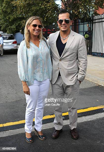John Leguizamo and his wife Justine Maurer attend the women's final on Day 14 of the 2014 US Open at USTA Billie Jean King National Tennis Center on...