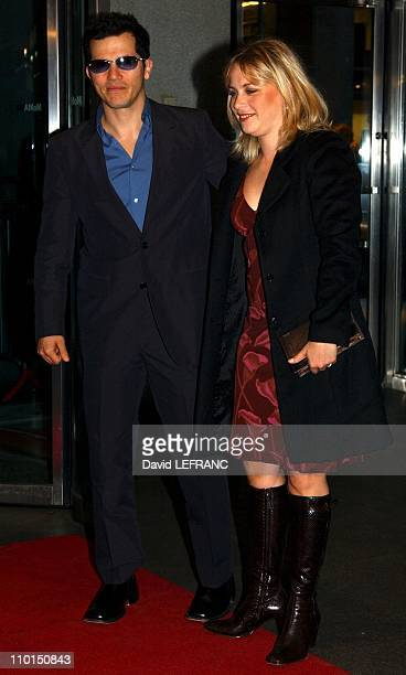 John Leguizamo and wife at the Museum of Modern Art for 'A Work in Progress An evening with David Russell' in New York United States on April 10 2002...