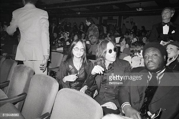 John Lennon accompanied by May Pang is at the Beacon Theater for the opening night performance of 'Sgt Pepper's Lonely Hearts Club Band on the Road'