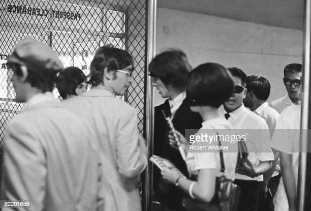 John Lennon and George Harrison at Manila International Airport after the Philippines leg of the Beatles' final world tour 5th July 1966 The group...