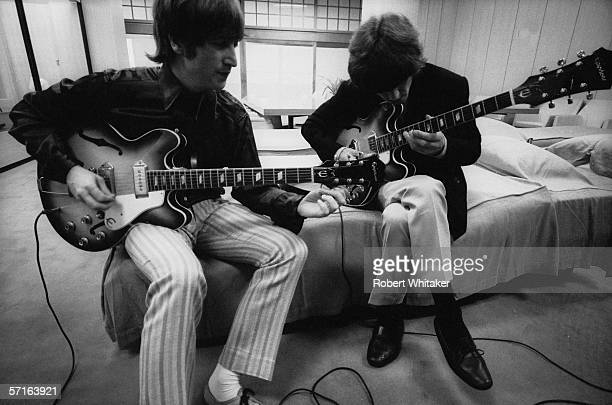 John Lennon and George Harrison backstage at the Nippon Budokan in Tokyo during the Beatles' Asian tour 1966