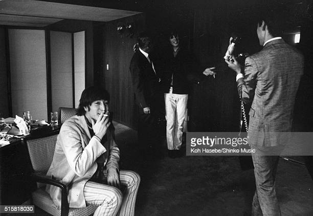 John Lennon and George Harrison of The Beatles during an interview for Japanese music magazine 'Music Life' Tokyo Hilton Hotel Japan July 2 1966
