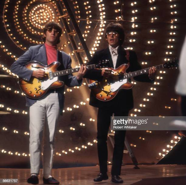 John Lennon and George Harrison of The Beatles playing live on Top of the Pops 1966