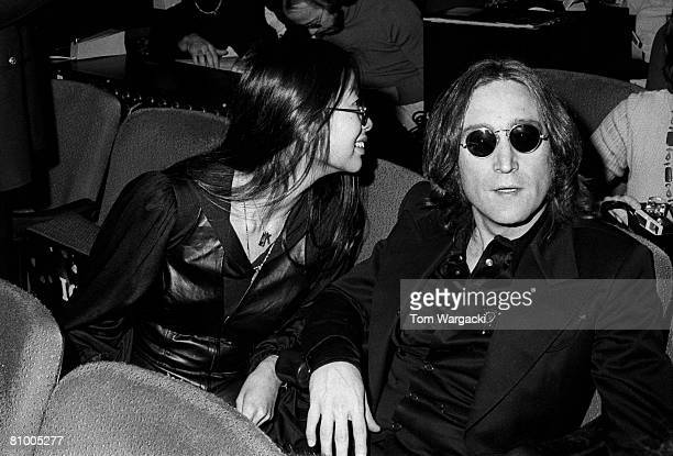 John Lennon and girlfriend May Pang at the Beacon Theatre for SGT Peppers Lonely Hearts Club Band on November 17 1974 in New York United States
