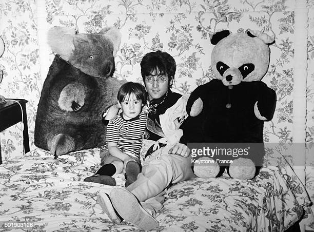 John Lennon and his son Julian relaxing at home in Weybridge United Kingdom circa 1960