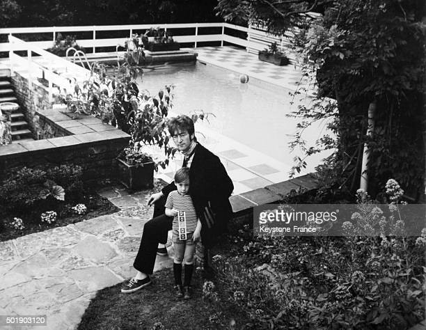 John Lennon and his son Julian relaxing in the garden of their home in Weybridge United Kingdom circa 1960
