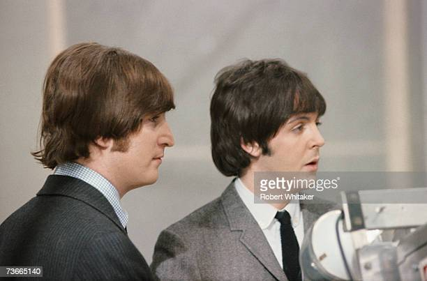 John Lennon and Paul McCartney of the Beatles on set during a break from recording a TV special 'The Music of Lennon and McCartney' at Granada...