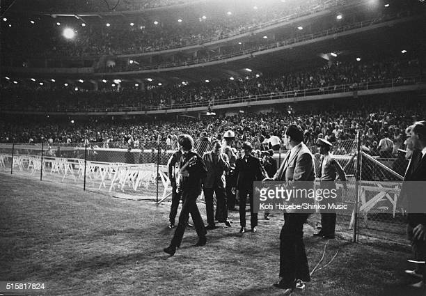 John Lennon and Ringo Starr of The Beatles running toward the stage at Dodger Stadium Los Angeles California August 28 1966