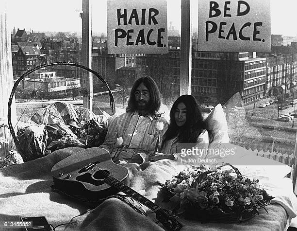 John Lennon and Yoko Ono give a press conference in bed in their Amsterdam hotel six days after their wedding in Gibraltar