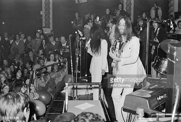 John Lennon and Yoko Ono performing with the Plastic Ono Band at the Lyceum Ballroom London 15th December 1969 Guitarists Eric Clapton and George...