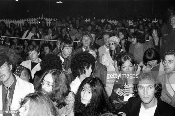 John Lennon and Yoko Ono pictured in the audience of the Isle of Wight pop festival 30th August 1969