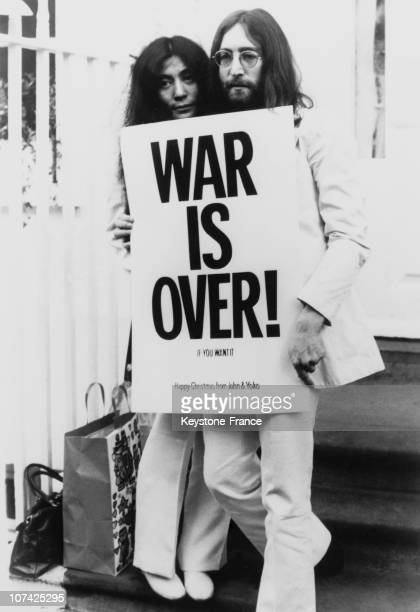 John Lennon and Yoko Ono pose on the steps of the Apple building in London holding one of the posters that they distributed to the world's major...