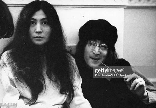 John Lennon and Yoko Ono sitting on the floor at the Apple Corps Christmas party London December 23 1968