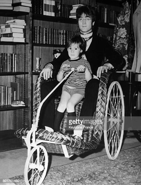 John Lennon at home with son Julian in 1965 in Weybridge United Kingdom