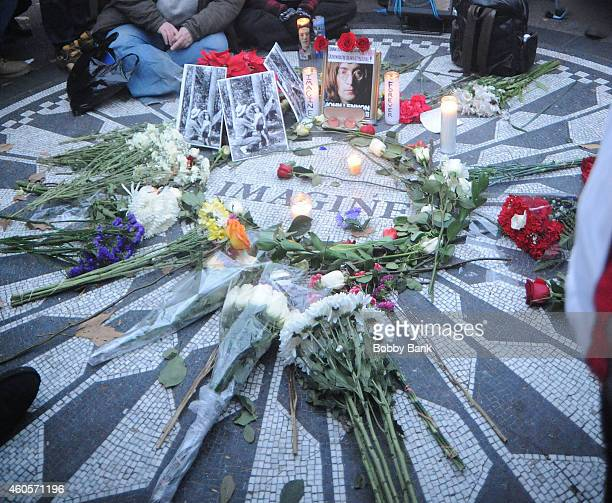 John Lennon fans gather at Strawberry Fields in Central Park and the Imagine mosaic plaque remembering John Lennon on the anniversary of his death at...