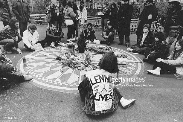 John Lennon fans gather at Strawberry Fields in Central Park on the anniversary of his death