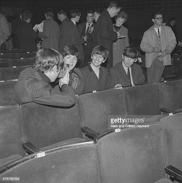 John Lennon films his fellow Beatles at the Gaumont Cinema Doncaster 10th December 1963 Left to right Lennon Paul McCartney Ringo Starr and George...