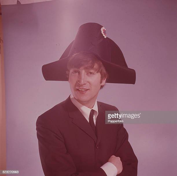 John Lennon guitarist with the Beatles posed wearing a bicorne hat in a photographic studio in Paris in January 1964