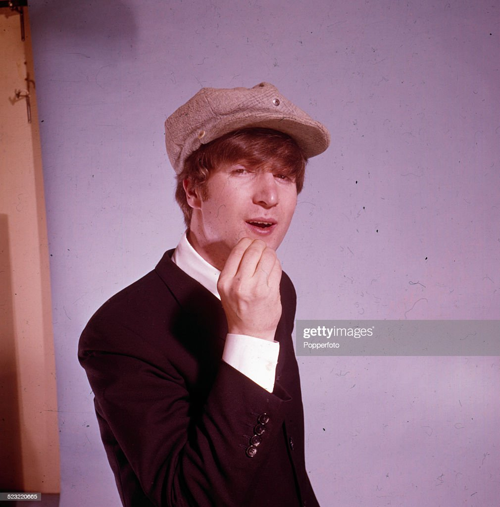 John Lennon (1940-1980) guitarist with the Beatles posed wearing a cap in a photographic studio in Paris in January 1964.