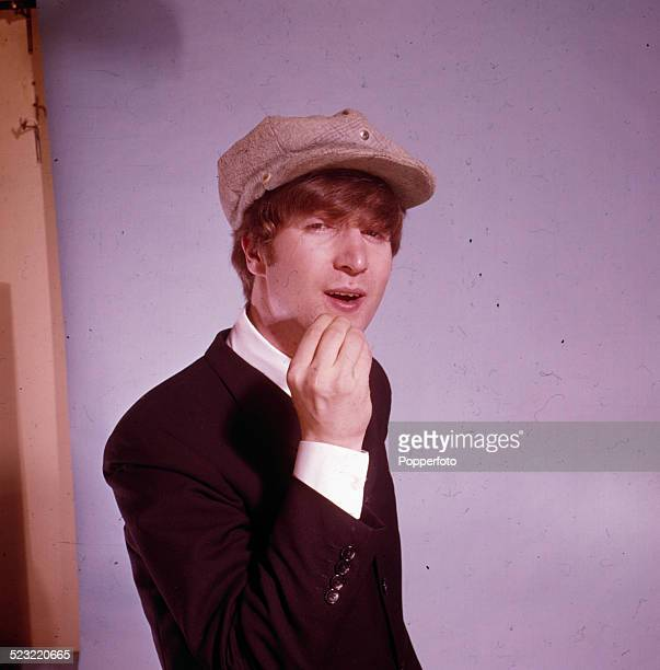 John Lennon guitarist with the Beatles posed wearing a cap in a photographic studio in Paris in January 1964