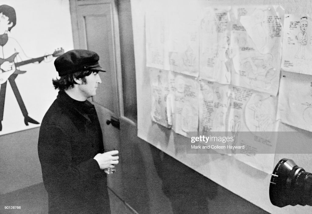 John Lennon Inspects The Drawings For The Forthcoming Beatles Cartoon News Photo Getty Images