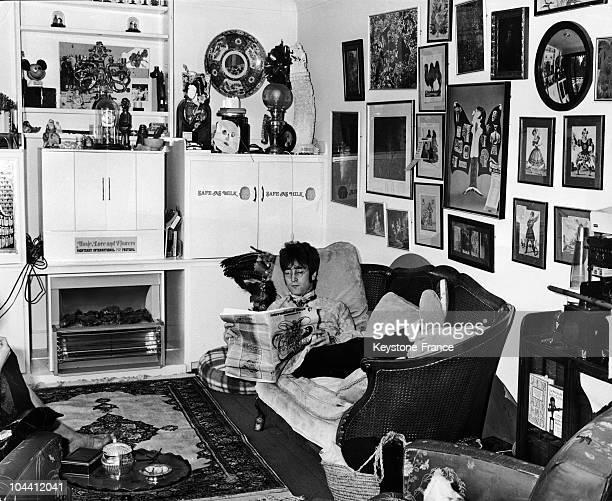 John LENNON lying on the sofa at home in Weybridge Britain around 1967
