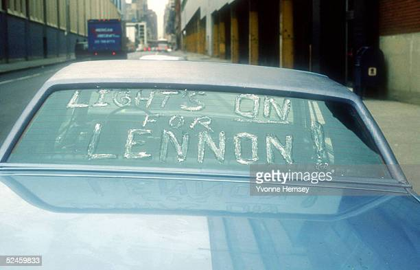 A John Lennon mourner expresses his sentiments on a car December 8 1980 in New York City after learning about the Beatle's murder