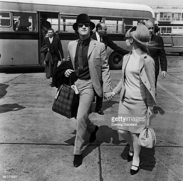 John Lennon of the Beatles at London Airport with his wife Cynthia 24th May 1965