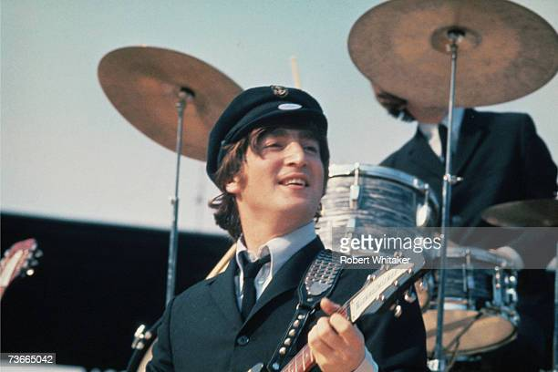 John Lennon of the Beatles during a matinee concert at Comiskey Park Chicago during the group's second US tour 20th August 1965