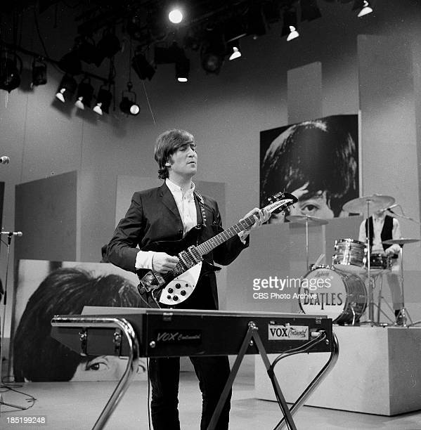 John Lennon of The Beatles during rehearsal for the third appearance on The Ed Sullivan Show. Image dated August 14, 1965.