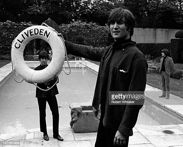 John Lennon of the Beatles framing Paul McCartney's face with a lifebelt during a break in the filming of 'Help' at Cliveden House in Buckinghamshire...