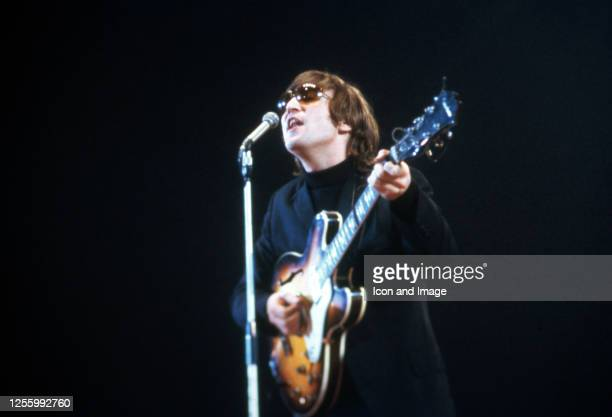 John Lennon of The Beatles performs at Empire Pool in Wembley at the New Musical Express Annual Poll Winner's Concert in what would be the band's...